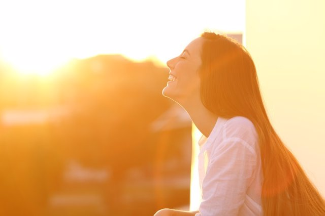 Archivo - Woman breathing at sunset in a balcony