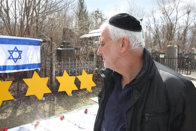 08 April 2021, Ukraine, Charkow: A man visits a memorial to Holocaust victims at Municipal Cemetery No.3 during a ceremony commemorating Holocaust and Heroism Day.Jewry. Photo: -/Ukrinform/dpa