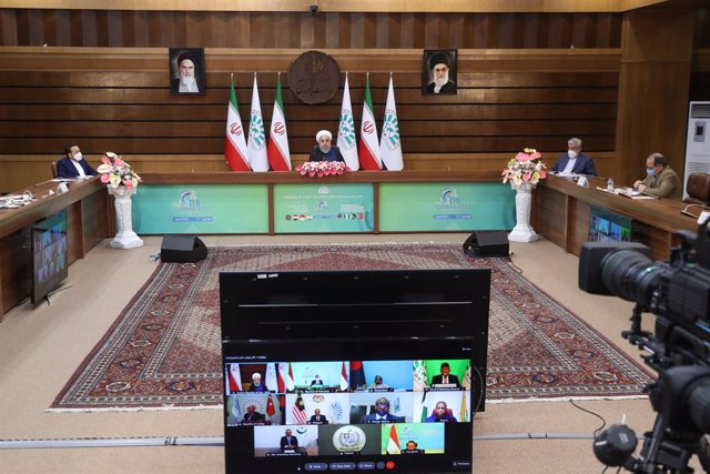 HANDOUT - 08 April 2021, Iran, Tehran: Iranian President Hassan Rouhani takes part in the 10th edition of the D-8 Summit via video conference. Photo: -/Iranian Presidency/dpa - ATTENTION: editorial use only and only if the credit mentioned above is refere