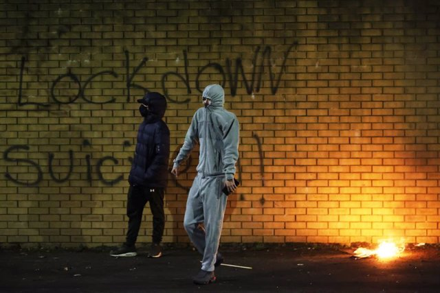 FILED - 07 April 2021, United Kingdom, Belfast: Rioters clash at Peace Gates in Lanark Way as unionists and nationalists clashed with the police and each other. Photo: Liam Mcburney/PA Wire/dpa