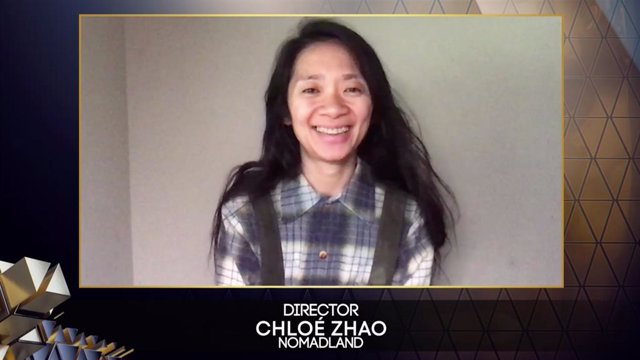 HANDOUT - 11 April 2021, United Kingdom, London: Avideo still released by Bafta shows director Chloe Zhao after winning the Best Director and Best Film awards for 'Nomadland' at the British Academy Film Award (BAFTA). Photo: Bafta/PA Media/dpa - ATTENTIO