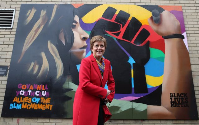 08 April 2021, United Kingdom, Glasgow: First Minister of Scotland and leader of the Scottish National Party (SNP) Nicola Sturgeon poses next to a Black Lives Matters mural in Glasgow as she campaigns for the Scottish Parliamentary election. Photo: Andrew