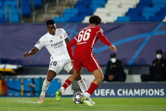 Vinicius Junior of Real Madrid and Trent Alexander-Arnold of Liverpool in action during the UEFA Champions League, Quarter finals round 1, football match played between Real Madrid and Liverpool FC at Alfredo Di Stefano stadium on April 06, 2021 in Valdeb