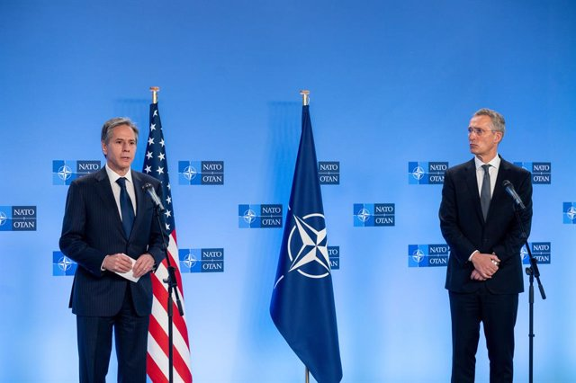 HANDOUT - 14 April 2021, Belgium, Brussels: NATO Secretary General Jens Stoltenberg (R) and US Secretary of State Antony Blinken speak during a press conference after their meeting at the NATO headquarters. Photo: -/NATO/dpa - ATTENTION: editorial use onl