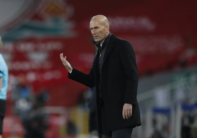 14 April 2021, United Kingdom, Liverpool: Real Madrid manager Zinedine Zidane stands on the sidelines during the UEFA Champions League quarter-finals, second-leg soccer match between Liverpool and Real Madrid at the Anfield. Photo: Darren Staples/CSM via