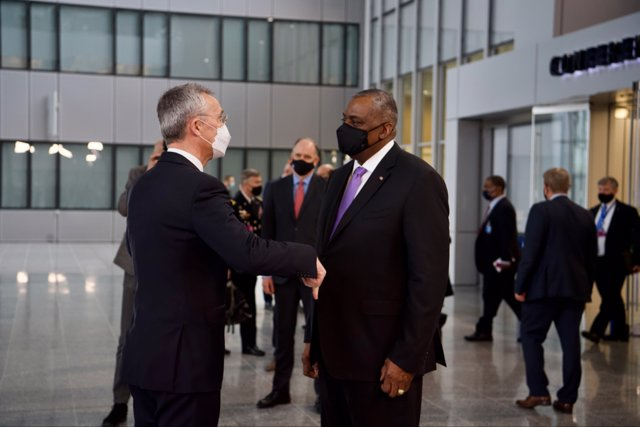 HANDOUT - 14 April 2021, Belgium, Brussels: NATO Secretary General Jens Stoltenberg (L) and US Secretary of Defense Lloyd Austin elbow bump prior to their meeting at NATO headquarters. Photo: -/NATO/dpa - ATTENTION: editorial use only and only if the cred