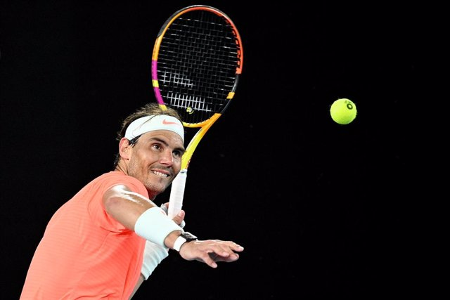 Archivo - Rafael Nadal of Spain hits the ball into the crowd after winning his second Round Men's singles match against Michael Mmoh of the USA on Day 4 of the Australian Open at Melbourne Park in Melbourne, Thursday, February 11, 2021. (AAP Image/Dean Le