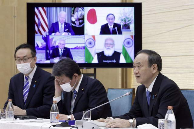 Archivo - 13 March 2021, Japan, Tokyo: Prime Minister of Japan Yoshihide Suga (R)takes part in a virtual meeting with Prime Minister of India Narendra Modi, President of the United States Joe Biden and Australian Prime Minister Scott Morrison as part of