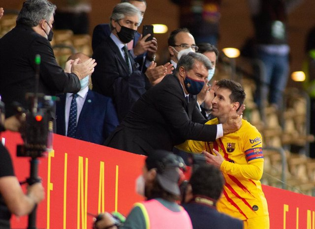 Joan Laporta, President of FC Barcelona and Lionel Messi of Barcelona during Copa Del Rey Final match between Athletic Club and Futbol Club Barcelona at Estadio de La Cartuja on April 17, 2021 in Seville, Spain.