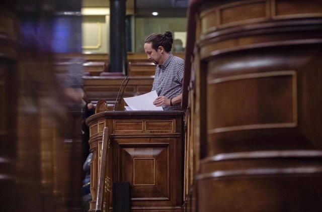El vicepresidente segundo del Gobierno, Pablo Iglesias, interviene en una sesión plenaria en el Congreso de los Diputados