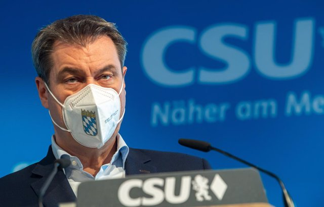 20 April 2021, Bavaria, Munich: Bavarian Minister President and leader of the Christian Social Union (CSU) Markus Soeder arrives to a press conference to deliver a statement. Soeder has conceded the race to lead Germany's conservatives into September elec