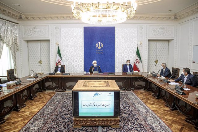 HANDOUT - 20 April 2021, Iran, Tehran: Iranian President Hassan Rouhani (C) speaks during a Government Economic Staff meeting. Photo: -/Iranian Presidency/dpa - ATTENTION: editorial use only and only if the credit mentioned above is referenced in full