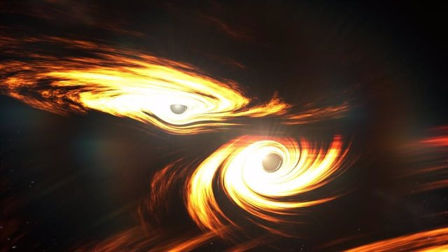 Artist's impression of binary black holes about to collide.