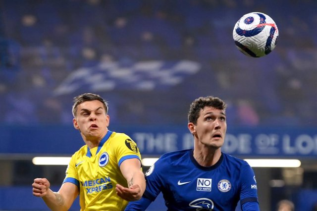 20 April 2021, United Kingdom, London: Brighton's Leandro Trossard (L) and Chelsea's Andreas Christensen battle for the ball during the English Premier League soccer match between Chelsea and Brighton & Hove Albion at Stamford Bridge. Photo: Mike Hewitt/P