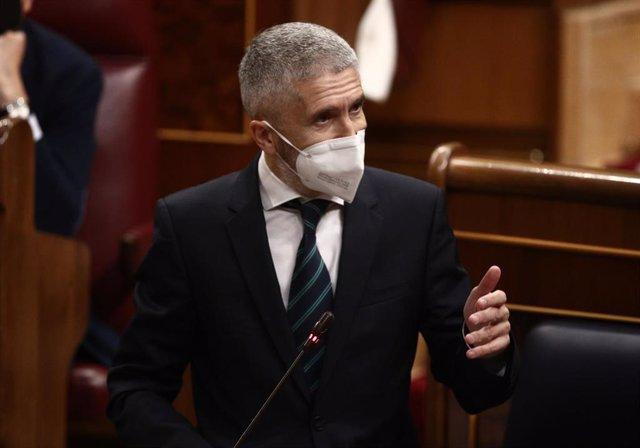 Archivo - El ministro del Interior, Fernando Grande-Marlaska, interviene durante una sesión de Control al Gobierno en el Congreso