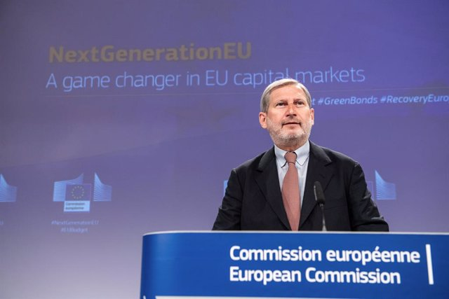 HANDOUT - 14 April 2021, Belgium, Brussels: Johannes Hahn, European Commissioner for Budget and Administration, speaks during a press conference on NextGenerationEU - Funding strategy to finance the Recovery Plan for Europe. Photo: Lukasz Kobus/European C