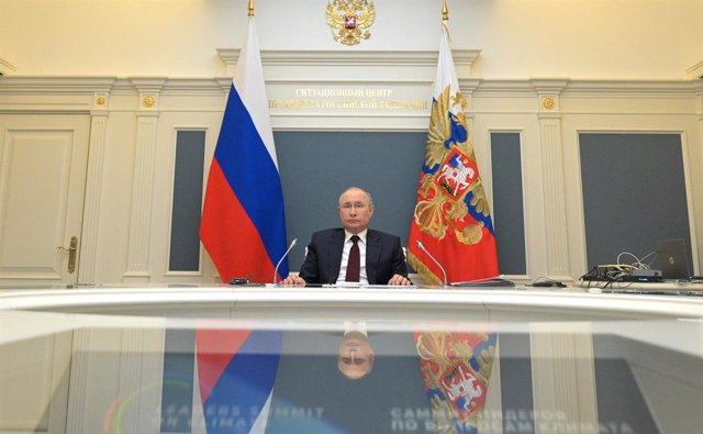 HANDOUT - 22 April 2021, Russia, Moscow: Russian President Vladimir Putin participates in the international climate summit via video with US President Joe Biden (on-screen). The meeting is intended to underline the urgency and economic benefits of stronge