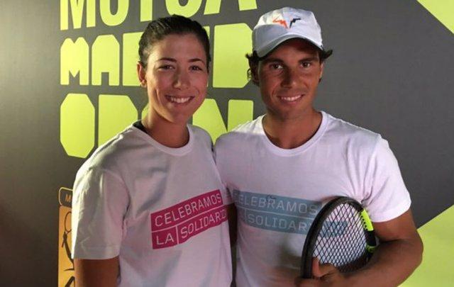 Archivo - Los tenistas Garbiñe Muguruza y Rafa Nadal en el Mutua Madrid Open
