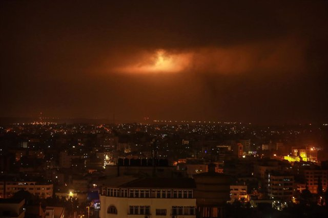 24 April 2021, Palestinian Territories, Gaza City: Lighting bombs fired by the Israeli army can be seen through the clouds after the Palestinian militants in Gaza City fired a number of rockets and missiles towards the Israeli side in Gaza City as a respo