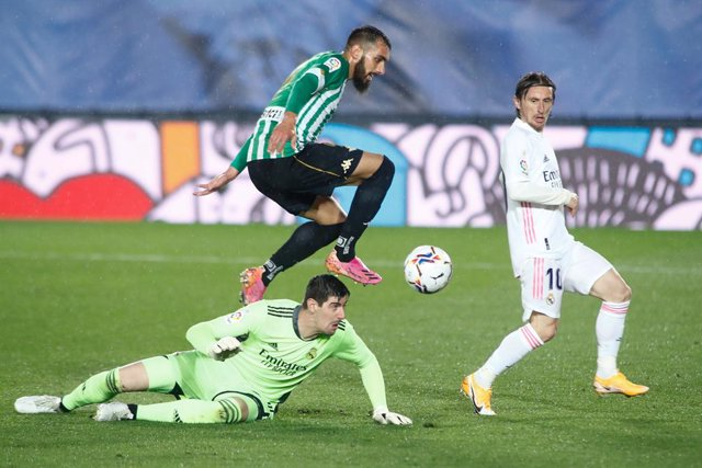 Borja Iglesias of Real Betis and Thibaut Courtois of Real Madrid in action during the spanish league, La Liga, football match played between Real Madrid and Real Betis at Ciudad Deportiva Real Madrid on April 24, 2021, in Valdebebas, Madrid, Spain.