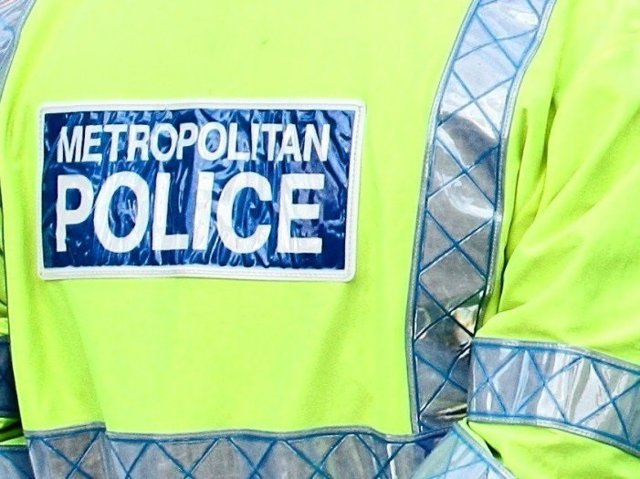 Archivo - Chaleco reflectante de la Policía Metropolitana de Londres, Scotland Yard