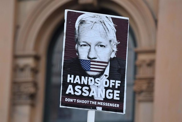 A placard is seen at a Free Julian Assange protest rally outside Sydney Town Hall in Sydney, Friday, April 23, 2021. Since his arrest on 11 April 2019, Assange has been incarcerated in HM Prison Belmarsh in London. (AAP Image/Mick Tsikas) NO ARCHIVING