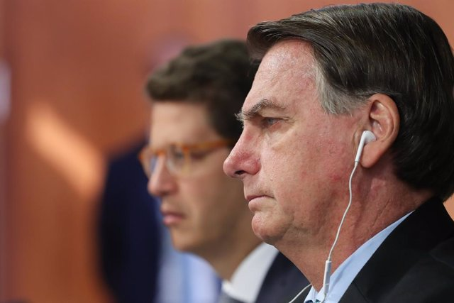 HANDOUT - 22 April 2021, Brazil, Brasilia: Brazilian President Jair Bolsonaro (R) attends the virtual Leaders Summit on Climate, called on by US President Joe Biden. Photo: Marcos Correa/Palácio do Planalto/dpa - ATTENTION: editorial use only and only if