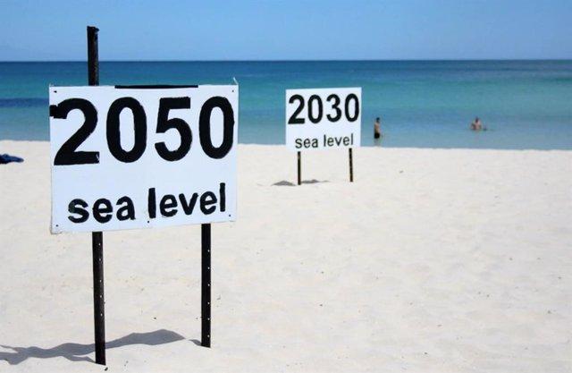 Ilustraciòn sobre la subida del nivel del mar