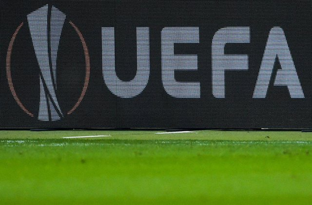 Archivo - FILED - 29 November 2018, Hessen, Frankfurt/Main: A general view of the UEFA logo displayed on an advertising board during the UEFA Europa League Group H soccer match between Eintracht Frankfurt and Olympique Marseille at the Commerzbank-Arena.