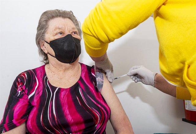 22 April 2021, Czech Republic, Most: An elderly woman receives a dose of a COVID-19 vaccine in a vaccination center. Photo: Hájek Ondej/CTK/dpa