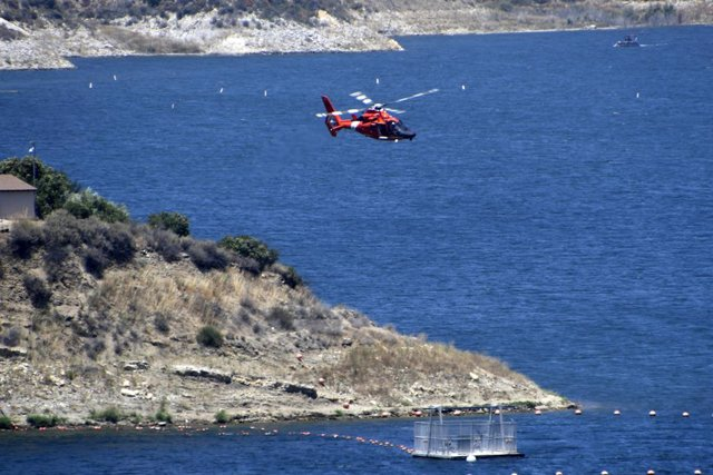 Archivo - 09 July 2020, US, Lake Piru: A helicopter of the US Coast Guard flies over Lake Piru in the search for the missing US actress Naya Rivera. Rivera disappeared after renting a boat with her 4-year-old son at Lake Piru north of Los Angeles. Photo: