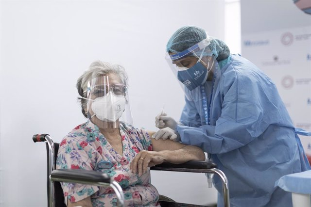22 April 2021, Peru, Lima: An elderly woman receives a dose of a COVID-19 vaccine in a vaccination center at the Carlos A. Moscoso Municipal Stadium. Photo: El Comercio/GDA via ZUMA Wire/dpa