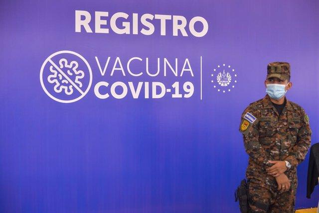 28 April 2021, El Salvador, San Salvador: A soldier stands next to the registration area at a Covid-19 drive-thru vaccination facility. Photo: Camilo Freedman/SOPA Images via ZUMA Wire/dpa