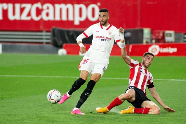 Youssef En-Nesyri of Sevilla and Oscar de Marcos of Athletic Club during LaLiga, football match played between Sevilla Futbol Club and Athletic Club at Ramon Sanchez Pizjuan Stadium on May 3, 2021 in Sevilla, Spain.