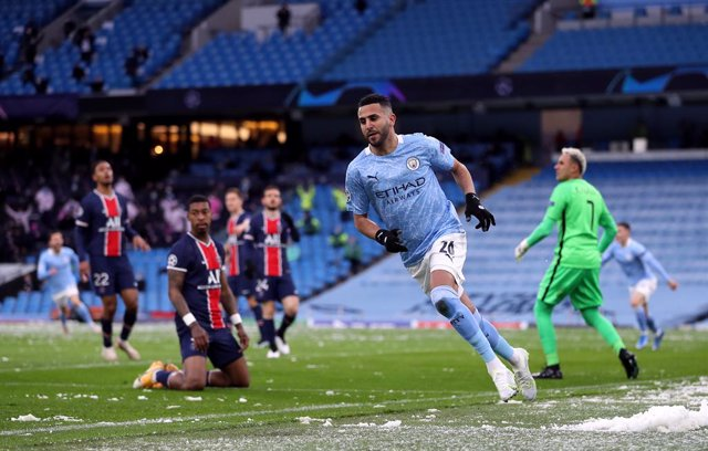 04 May 2021, United Kingdom, Manchester: Manchester City's Riyad Mahrez celebrates scoring his side's first goal during the UEFA Champions League Semi-Final second leg soccer match between Manchester City and Paris Saint-Germain at the Etihad Stadium. Pho