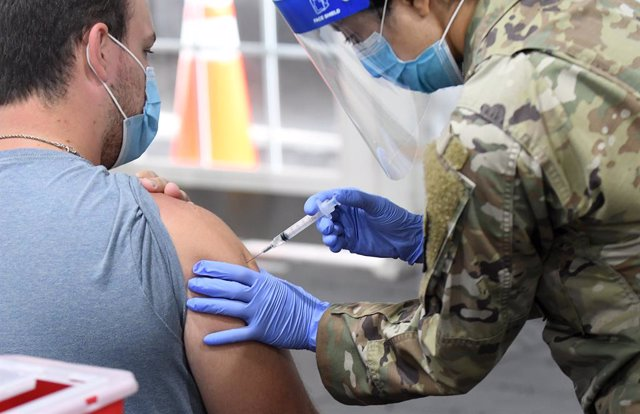 25 April 2021, US, Orlando: A man gets vaccinated against Coronavirus at the FEMA-supported COVID-19 vaccination site at Valencia State College, on the first day the site resumed offering the Johnson & Johnson vaccine following the lifting of the pause or