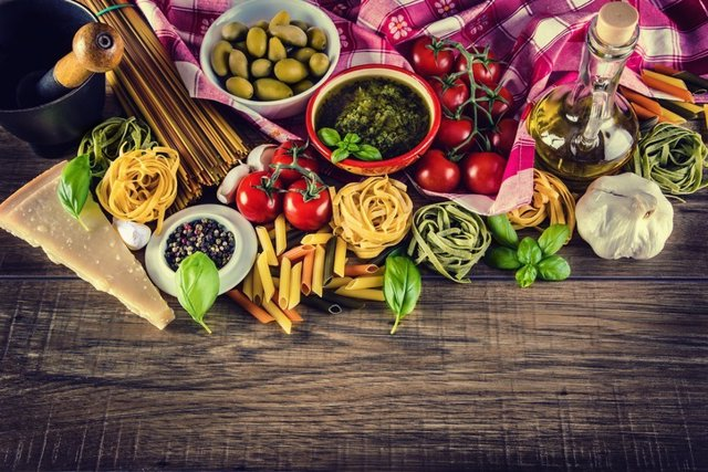 Archivo - Italian and Mediterranean food ingredients on old wooden background.