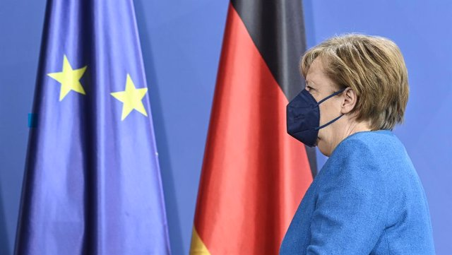08 May 2021, Berlin: German Chancellor Angela Merkel leaves the press conference after a statement on the informal EU summit and the EU-China summit . Photo: John Macdougall/AFP-Pool/dpa