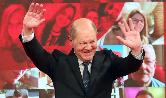 09 May 2021, Berlin: German Minister of Finance Olaf Scholz cheers during the Social Democratic Party of Germany (SPD) online federal party conference, after delegates nominated him as candidate for Chancellor. Photo: Wolfgang Kumm/dpa
