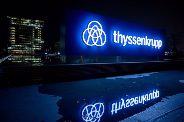 Archivo - FILED - 20 November 2019, North Rhine-Westphalia, Essen: The ThyssenKrupp logo is reflected on a water surface. German steel and engineering conglomerate Thyssenkrupp has finally completed the sale of its profitable elevator division to a consor