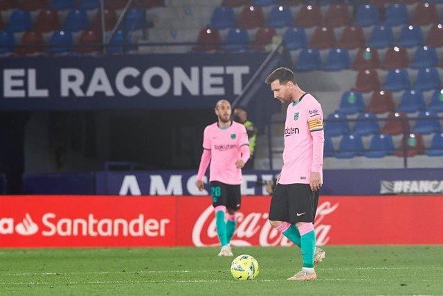 Lionel Messi of FC Barcelona reacts during the La Lliga Santander match between Levante and FC Barcelona at Estadi Ciutat de València on 11 May, 2021 in València, Spain