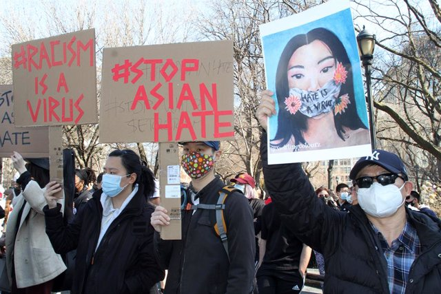 Archivo - 21 March 2021, US, New York: Members and supporters of the Asian-American community hold placards during a 'rally against hate' at Manhattan's Union Square. Eight people, most of them of Asian descent, were killed and one injured in shootings at