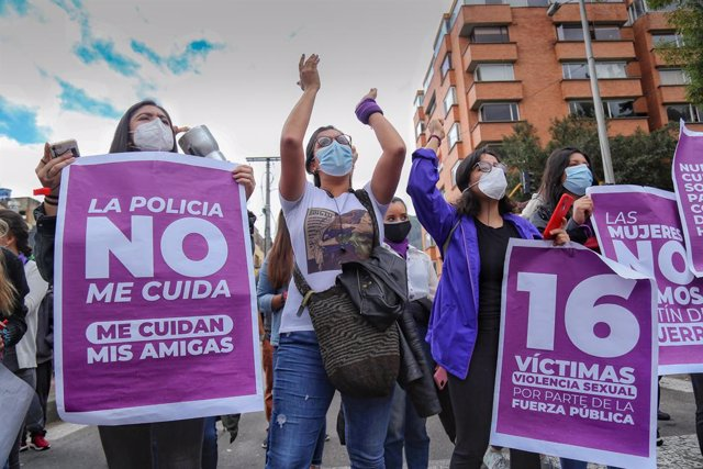 14 May 2021, Colombia, Bogota: Women hold signs during a demonstration against alleged gender abuses committed by the security forces as part of the national strike against the government of Colombian President Ivan Duque Marquez. Photo: Camila Díaz/colpr