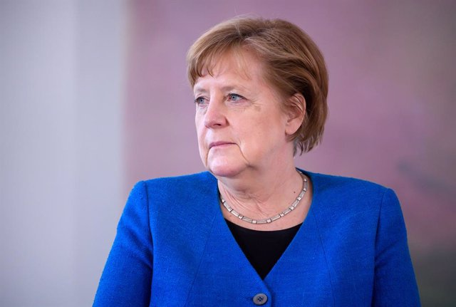 20 May 2021, Berlin: German Chancellor Angela Merkel sits during the presentation of the certificate of dismissal to the previous Minister for Family Affairs Giffey and the certificate of appointment as the new  Minister for Family Affairs to Minister of
