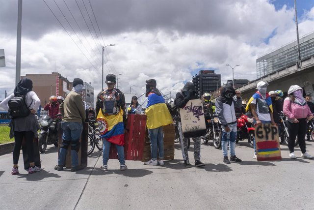15 May 2021, Colombia, Bogota: Protesters take part in a march during the national strike against the government of Colombian President Ivan Duque Marquez. Photo: Daniel Garzon Herazo/ZUMA Wire/dpa