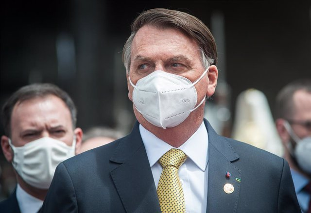 24 May 2021, Ecuador, Quito: Brazilian President Jair Bolsonaro leaves the National Assembly wearing a mask after the inauguration of the president of Ecuador Guillermo Lasso. Photo: Juan Diego Montegro/