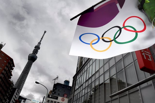 21 May 2021, Japan, Tokyo: A Tokyo 2020 banner can be seen hanging from an electricity pole. Photo: Ramiro Agustin Vargas Tabares/ZUMA Wire/dpa