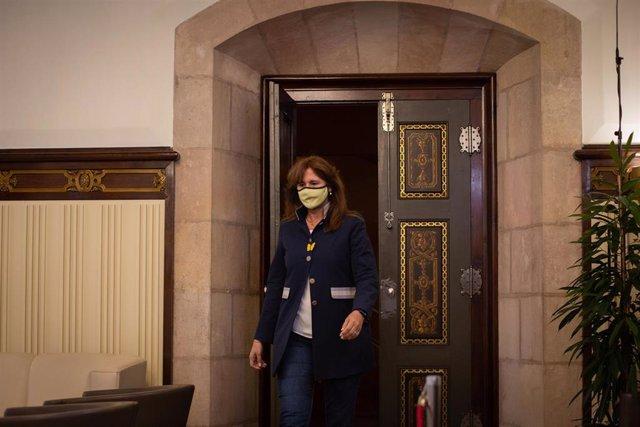 La presidenta del Parlament, Laura Borràs a su llegada a una rueda de prensa para proponer al vicepresidente del Govern en funciones, Pere Aragonès (ERC), como candidato a ser investido presidente de la Generalitat, en el Parlament, a 19 de mayo de 2021,