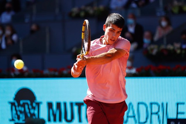 Carlos Alcaraz of Spain in action during his Men's Singles match, round of 32, against Rafael Nadal of Spain on the ATP Masters 1000 - Mutua Madrid Open 2021 at La Caja Magica on May 5, 2021 in Madrid, Spain.