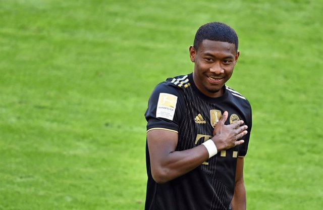 22 May 2021, Bavaria, Munich: Munich's David Alaba reacts during his farewell before the start of the German Bundesliga soccer match between FC Bayern Munich and FC Augsburg at Allianz Arena. Photo: Sven Hoppe/dpa-Pool/dpa - IMPORTANT NOTICE: DFL and DFB
